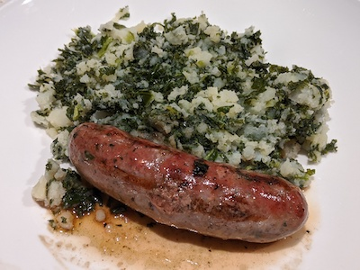 Mashed potatoes with kale and beef sausage
